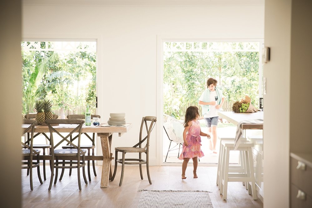 How should your windows be positioned in order to get the best natural lighting possible?