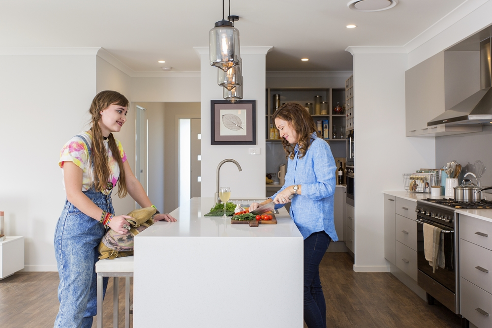 Keep your kitchen pristine by adding a butler's pantry to your new home.